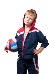 The cute little boy in a jumpsuit holds a volleyball ball.