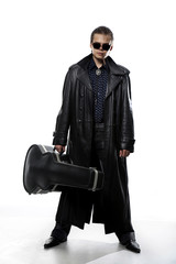 Man with guitar case