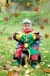 Cute child wihtin falling leaves_outdoor