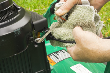 checking oil on a lawn mower