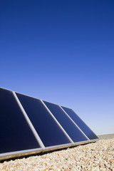 Solar panels on the roof against blue sky