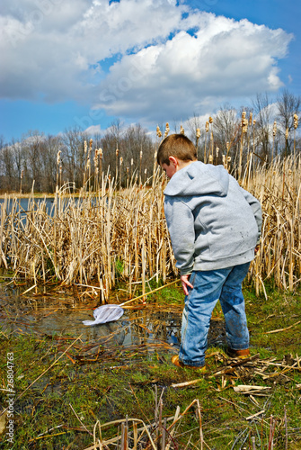 Boy Exploring Swamp