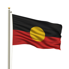 Aboriginal flag waving in the wind in front of white background