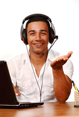 Smiling office worker with headphone gestures with hand