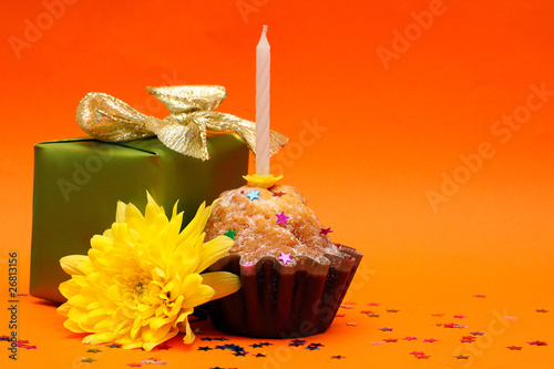 Birthday cupcake, gift and flower on paper - holiday background