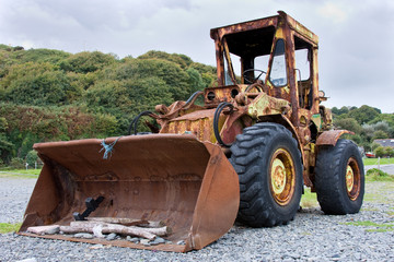 Large Old Rusty Digger Used for Clearing Pebble Beach
