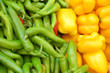 close up of yellow and green peppers