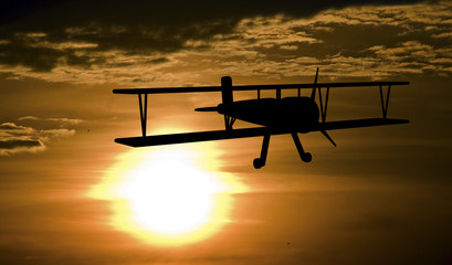 Airplane and sunset