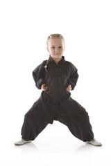 girl - karateka in a black kimono on a white background
