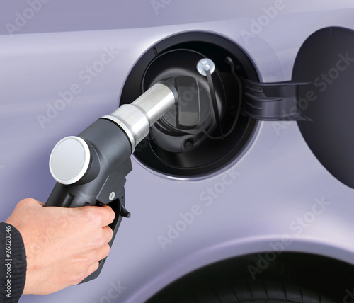 putting gas into the car