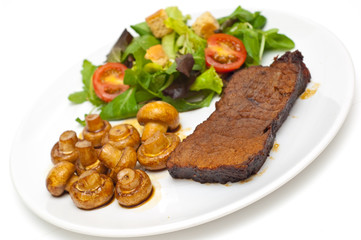 roastbeef muchrooms and salad on a white background