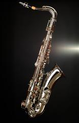 gold saxophone on black background
