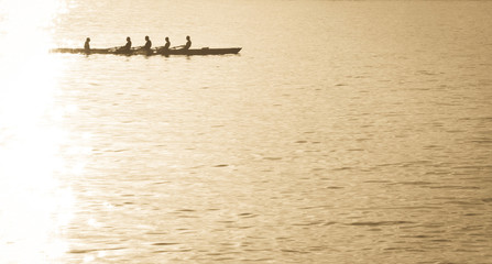 Rowing through the glare.