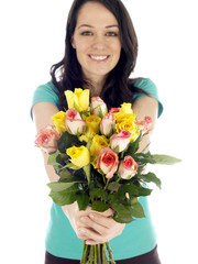 Young Woman Holding Bunch of Flowers. Model Released