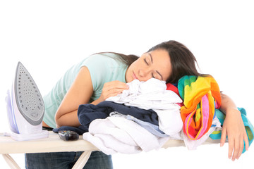 Young Woman Asleep on Pile of Ironing. Model Released