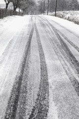 tire prints on a country road after heavy snowfall