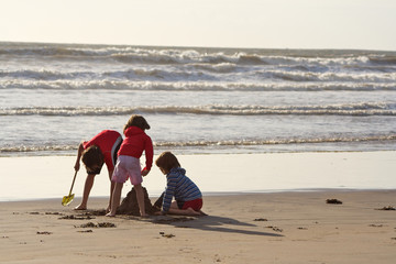 Children Digging at Beach