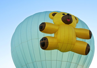 Hot Air Balloon with a Teddy Bear high in the sky.