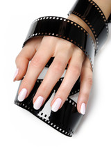 Beautiful hand with perfect nail pink manicure and photo film. i