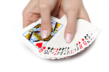 Beautiful hands with perfect  manicure holding a deck of playing