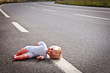 doll leave on a highway lane