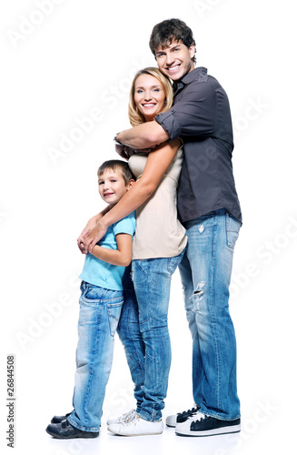 Full portrait of happy family with child standing on white