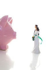 wedding couple and piggy bank ( financial troubles concept )