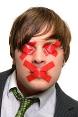 businessman's eyes and mouth taped with red crosses