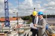 Businessmen on construction site