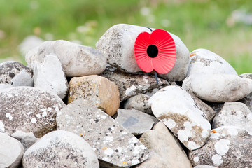 Remebrance Day Poppy Emblem on Stone Cairn Close Up