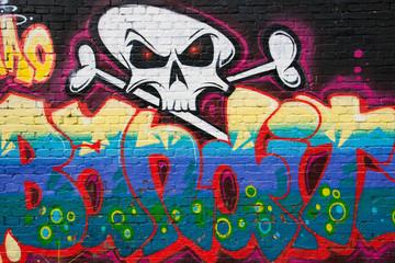 Graffiti on a brickwall in Berlin