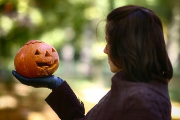 Woman with pumpkin in hand