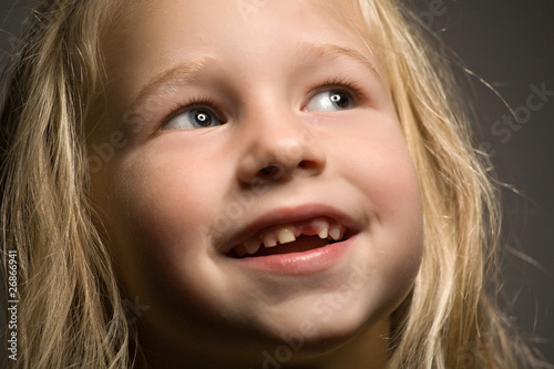 little girl without one front tooth