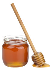 honey in jar and dipper isolated