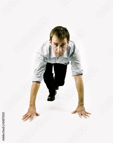 Businessman in sprint position