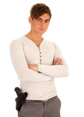 young man with gun and crossed arms