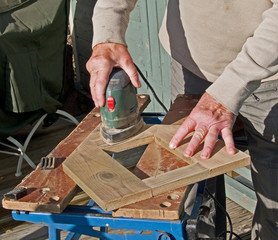 Sanding wood with an electric sanding tool