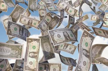 dollar bills flying in the sky