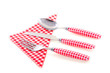 modern red white checkered cutlery with a napkin isolated on whi
