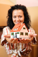 Woman with miniature house