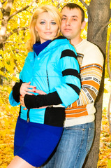 young couple in autumn forest