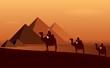 Camel_egypt : Caravan camels among desert and pyramids.  Stock Photo.