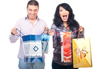 Happy shoppers couple with bags