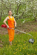 woman gardening with  lawn mower