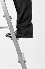 Man's legs on ladder