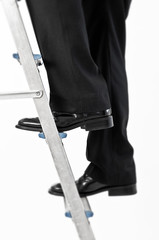 Business man climbing ladder