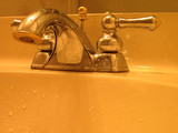 close up shot of a faucet in the bathroom