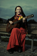 Outdoor portrait of woman with guitar