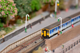 miniature model commuter train in a station poster