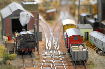 trains in a miniature model freight yard